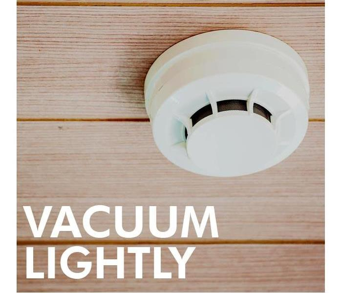 Smoke alarm with the phrase Vacuuming lightly