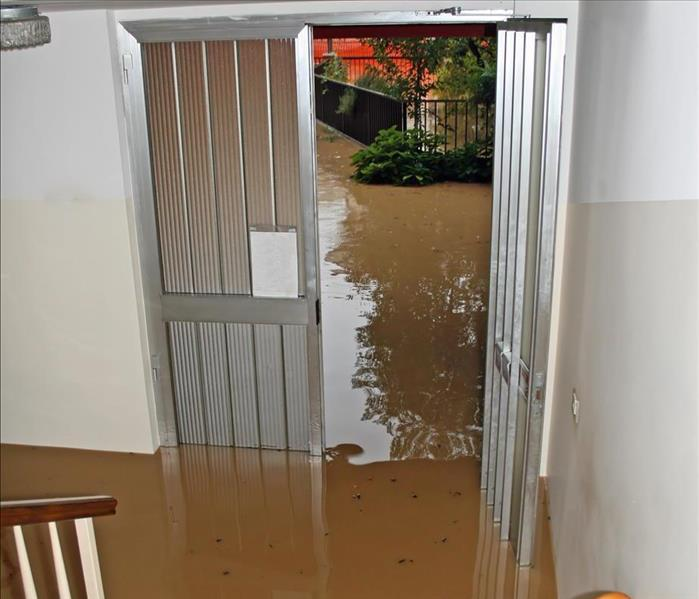 A flooded entrance of a home